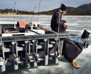 A fisherman on the ice with a modified ice sled.